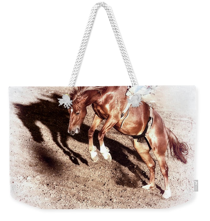 Rodeo Weekender Tote Bag featuring the photograph Never Give In by Caitlyn Grasso