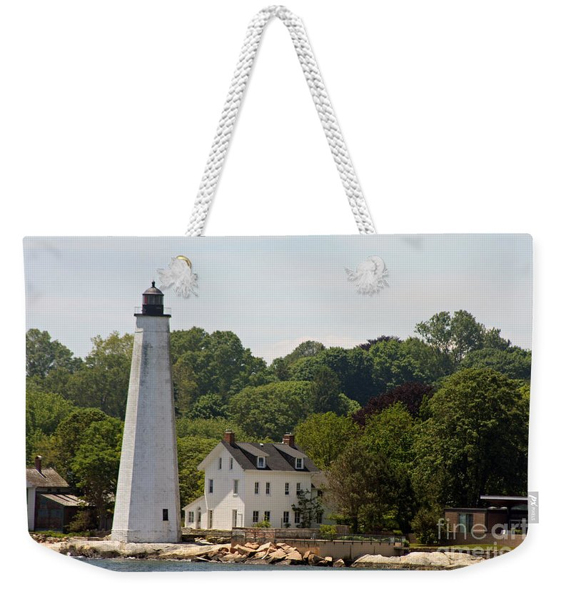 New London Harbor Weekender Tote Bag featuring the photograph New London Harbor Lighthouse by Christiane Schulze Art And Photography