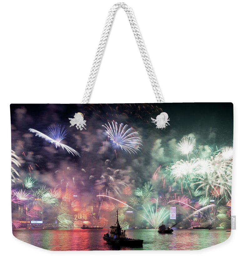 Firework Display Weekender Tote Bag featuring the photograph New Year Fireworks Hong Kong Asia by Steffen Schnur