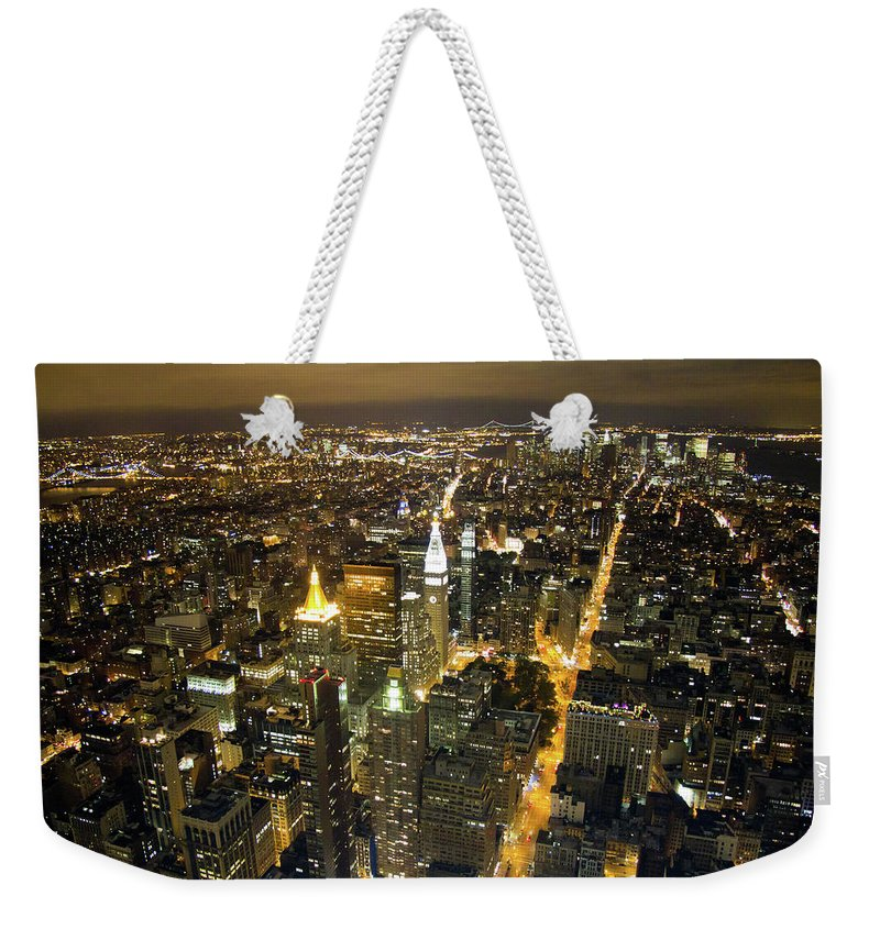 New York Weekender Tote Bag featuring the photograph New York By Night by Bill Lindsay