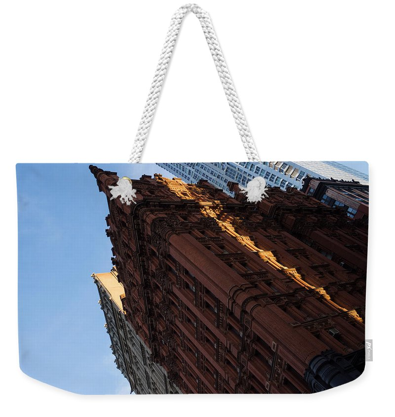 Angled View Weekender Tote Bag featuring the photograph New York City - An Angled View Of The Potter Building At Sunrise by Georgia Mizuleva