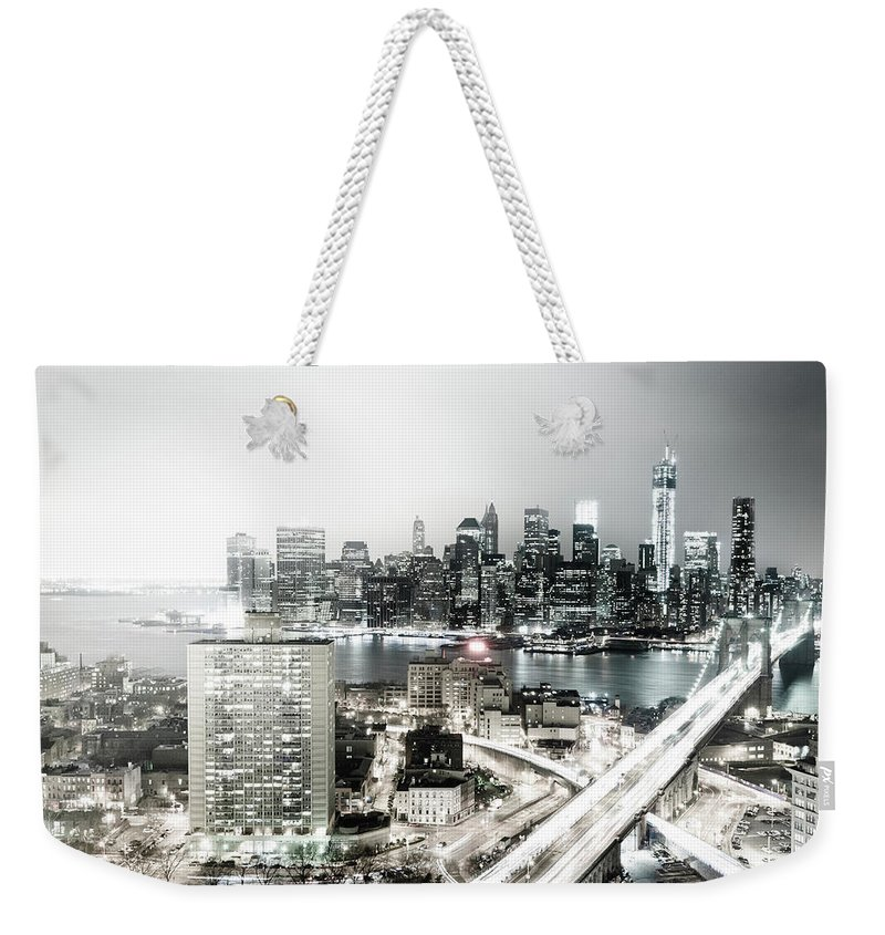 Lower Manhattan Weekender Tote Bag featuring the photograph New York City Skyline At Night by Mundusimages