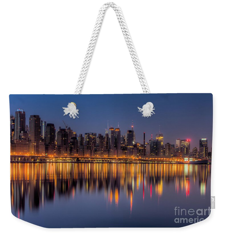 Clarence Holmes Weekender Tote Bag featuring the photograph New York City West Side Morning Twilight I by Clarence Holmes
