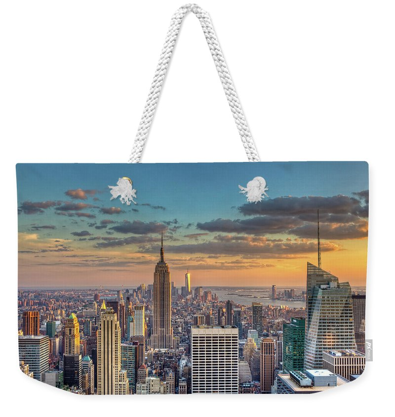 Tranquility Weekender Tote Bag featuring the photograph New York Skyline Sunset by Basic Elements Photography