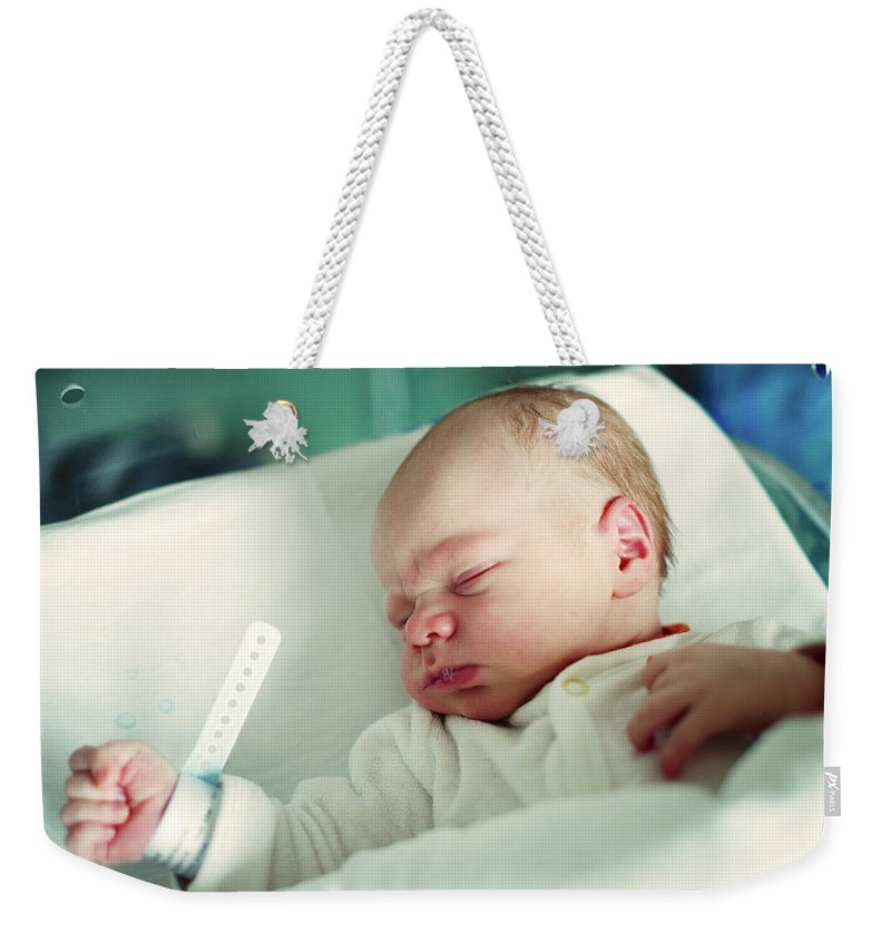Tranquility Weekender Tote Bag featuring the photograph Newborn Boy. First Day by Aleksandr Morozov