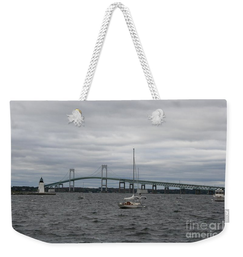 Bridge Weekender Tote Bag featuring the photograph Newport Bridge With Newport Harbor Light by Christiane Schulze Art And Photography