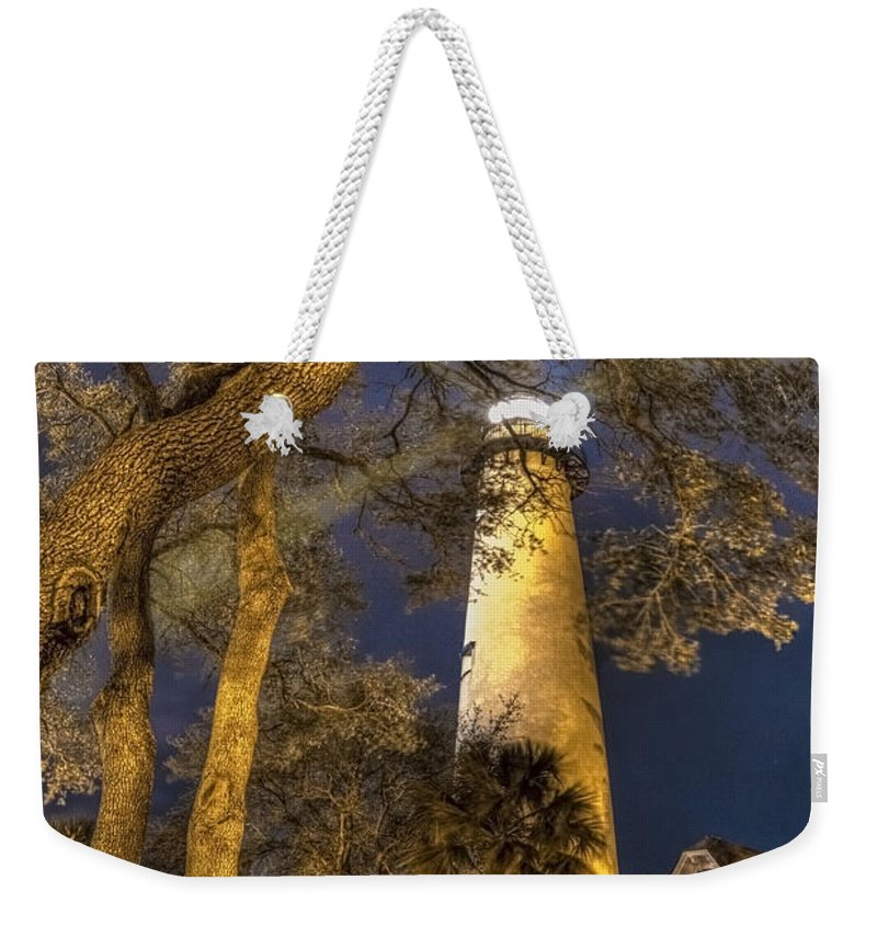 Clouds Weekender Tote Bag featuring the photograph Night Lighthouse by Debra and Dave Vanderlaan