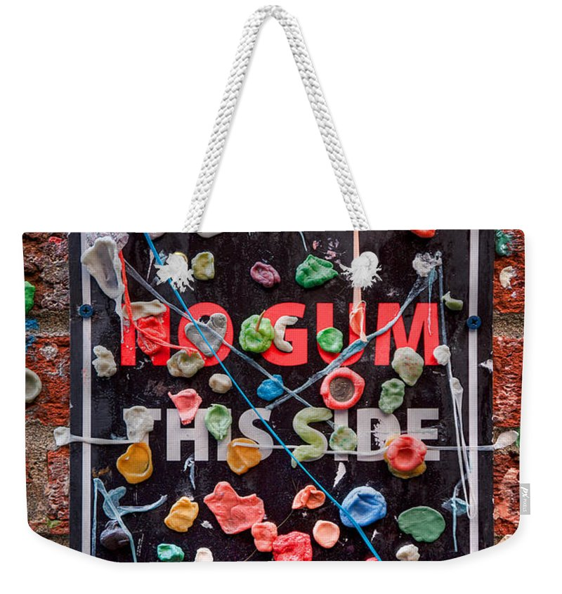 Gum Wall Weekender Tote Bag featuring the photograph No Gum Zone by Spencer McDonald