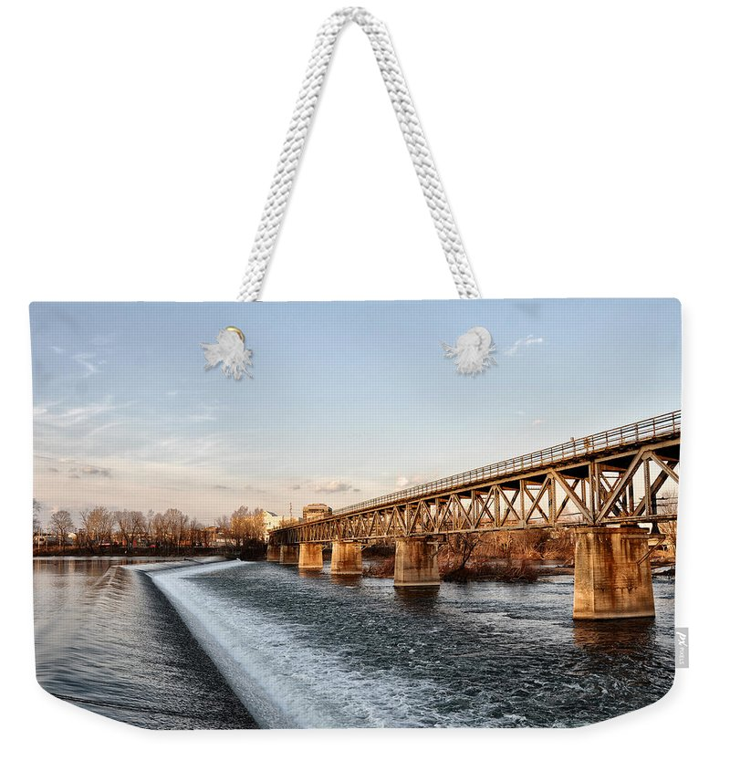 Norristown Weekender Tote Bag featuring the photograph Norristown Dam And Railroad Bridge by Bill Cannon