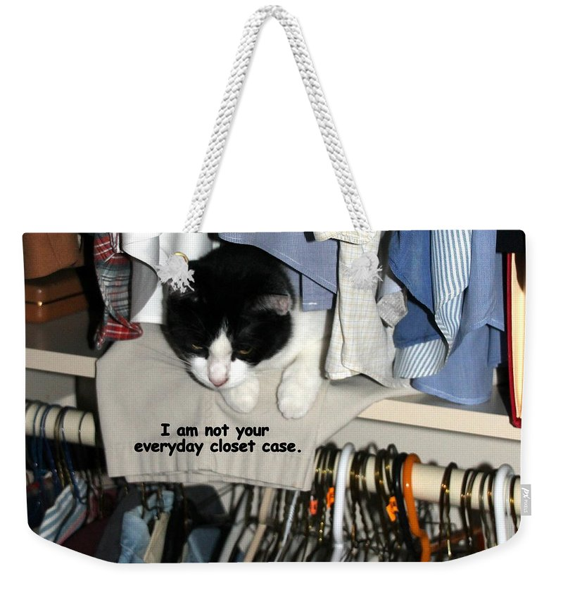 Cat Weekender Tote Bag featuring the photograph Not Your Everyday Closet Case by Laurel Talabere