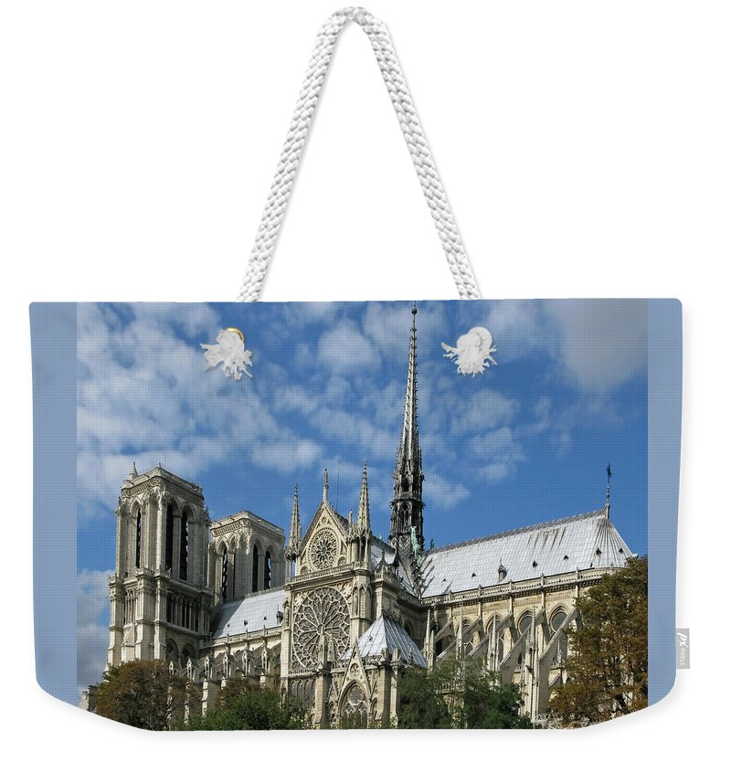Notre Dame Weekender Tote Bag featuring the photograph Notre Dame Cathedral by Ann Horn