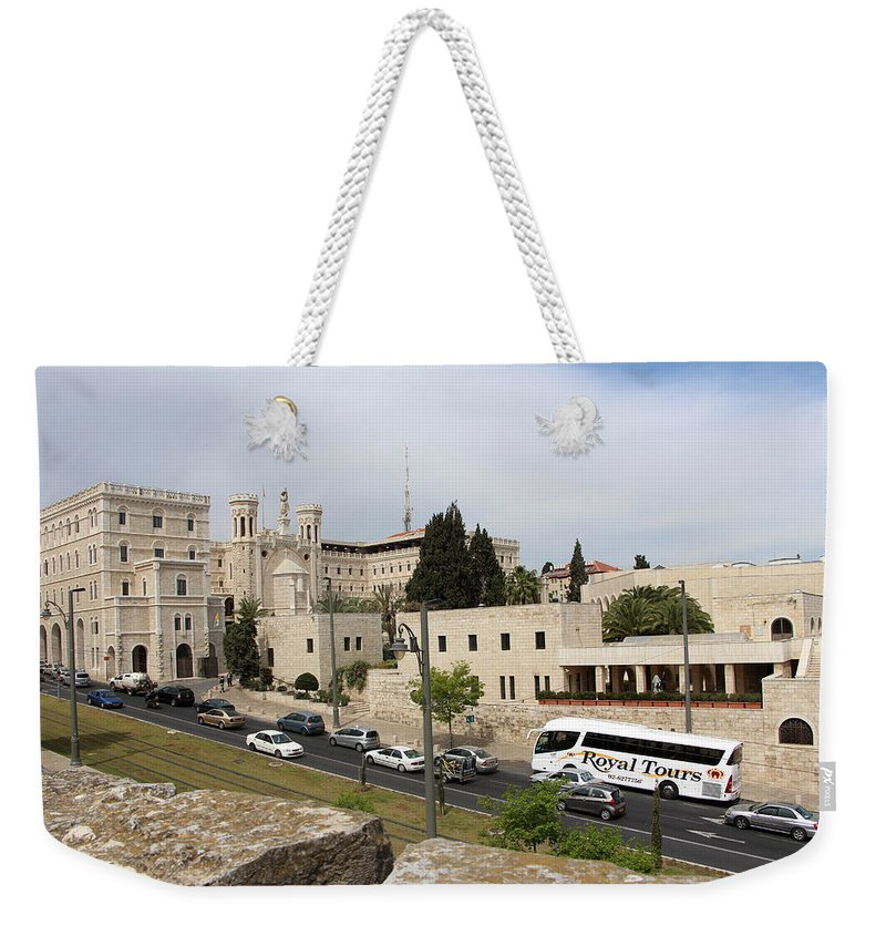 Notre Weekender Tote Bag featuring the photograph Notre Dame by Munir Alawi