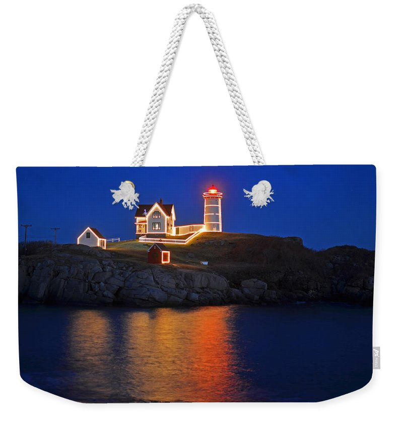 York Weekender Tote Bag featuring the photograph Nubble Light In York Me Cape Neddick Christmas Blue Sky by Toby McGuire