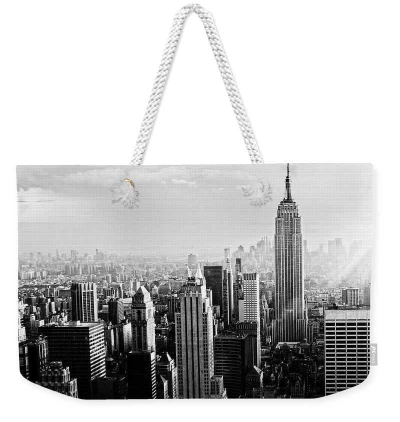 Lower Manhattan Weekender Tote Bag featuring the photograph Nyc Skyline.black And White by Lisa-blue