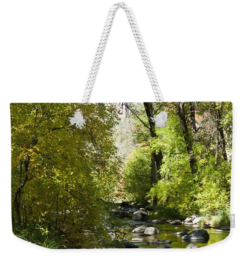 Red Weekender Tote Bag featuring the photograph Oak Creek Canyon Creek Arizona by Douglas Barnett