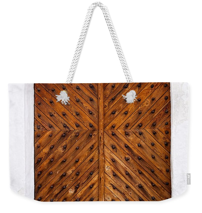 Old Weekender Tote Bag featuring the photograph Oak Double Door by Les Palenik