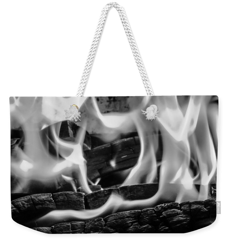 Fire Flames Weekender Tote Bag featuring the photograph Oakwood Flames by Mair Hunt