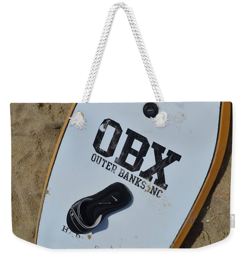 An Obx Outer Banks Surf Board Laying Out On The Beach. Weekender Tote Bag featuring the photograph Obx Outer Banks Surf Board by Robert Loe