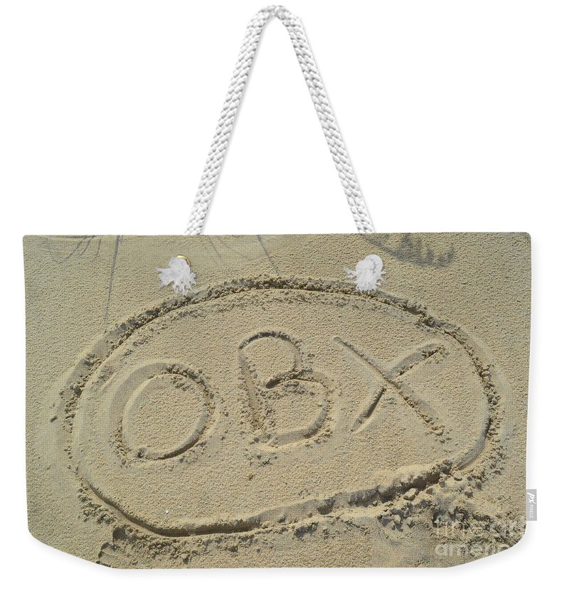 An Obx Outer Banks Sign Drew In The Sand At Cape Hatteras Beach. Obx Weekender Tote Bag featuring the photograph Obx Sign In The Sand by Robert Loe