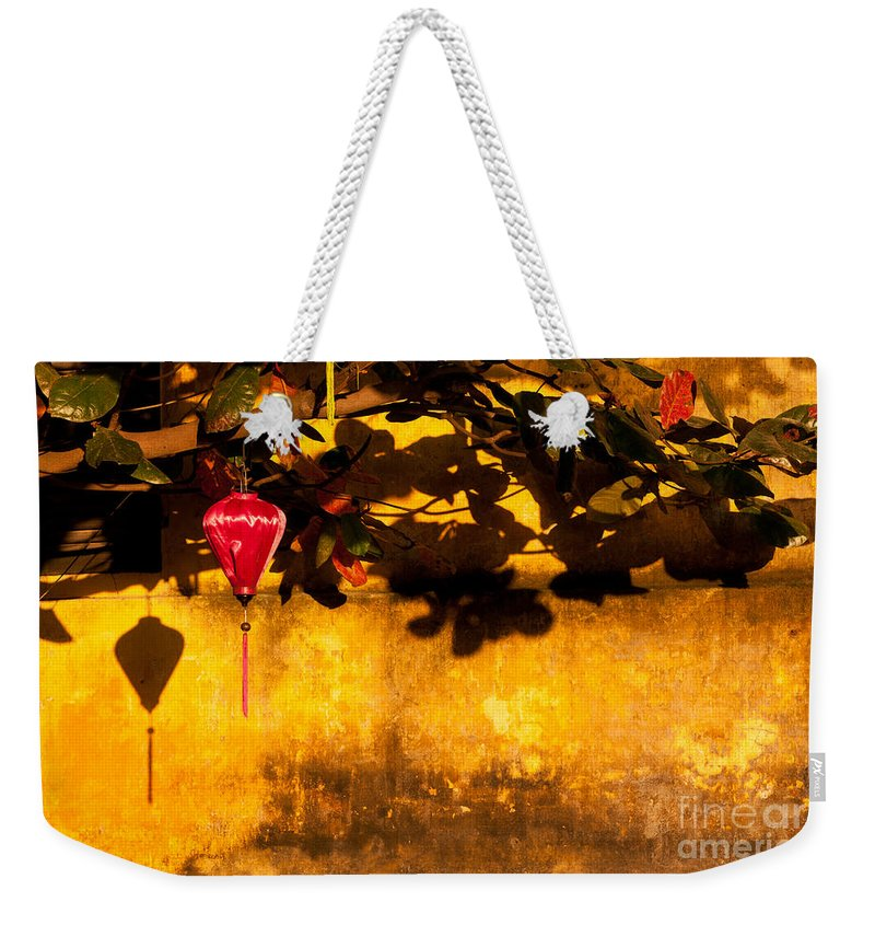 Vietnam Weekender Tote Bag featuring the photograph Ochre Wall Silk Lantern 01 by Rick Piper Photography
