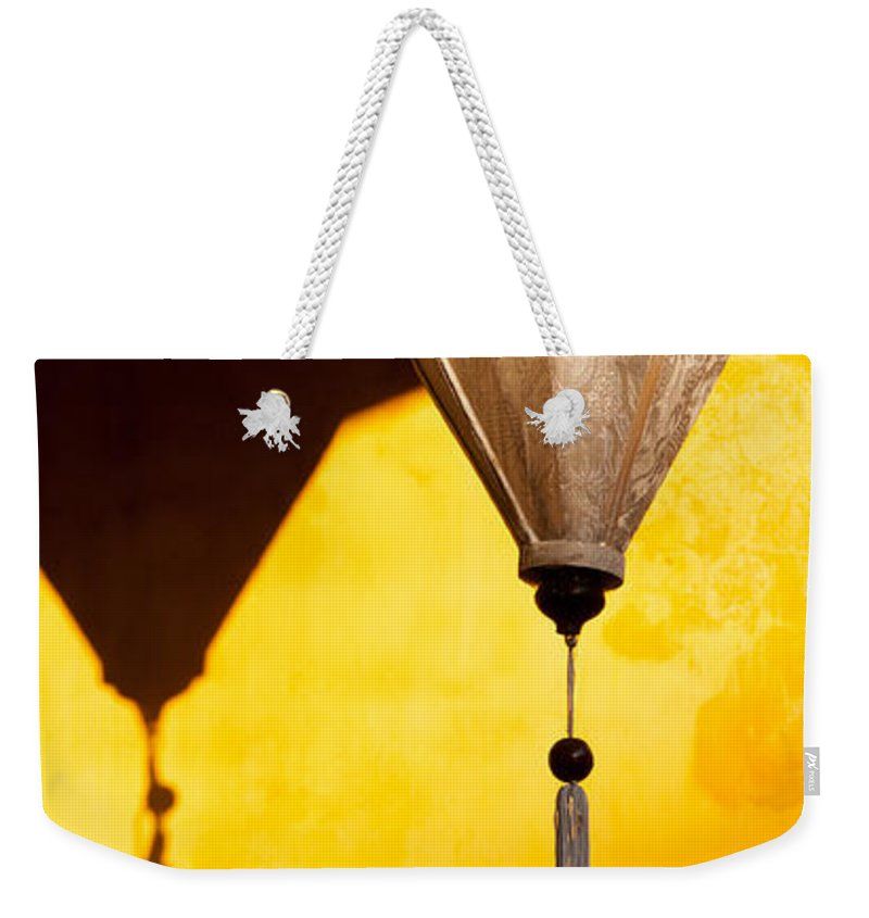 Vietnam Weekender Tote Bag featuring the photograph Ochre Wall Silk Lanterns by Rick Piper Photography