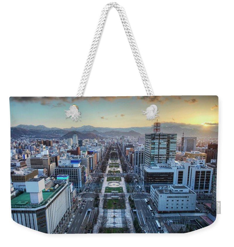 Hokkaido Weekender Tote Bag featuring the photograph Odori Park Sunset by Daniel Chui
