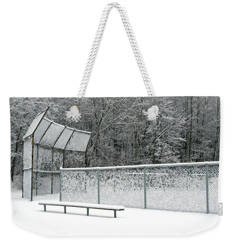 Winter Weekender Tote Bag featuring the photograph Off Season by Ann Horn