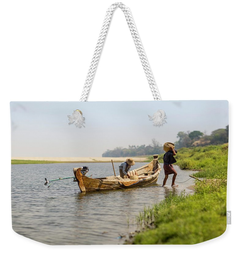 Working Weekender Tote Bag featuring the photograph Offloading Construction Details From by Merten Snijders