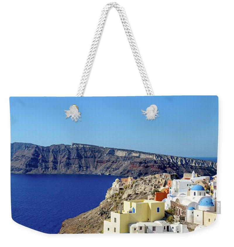 Scenics Weekender Tote Bag featuring the photograph Oia Panoramic, Santorini, Greece by Chrishepburn