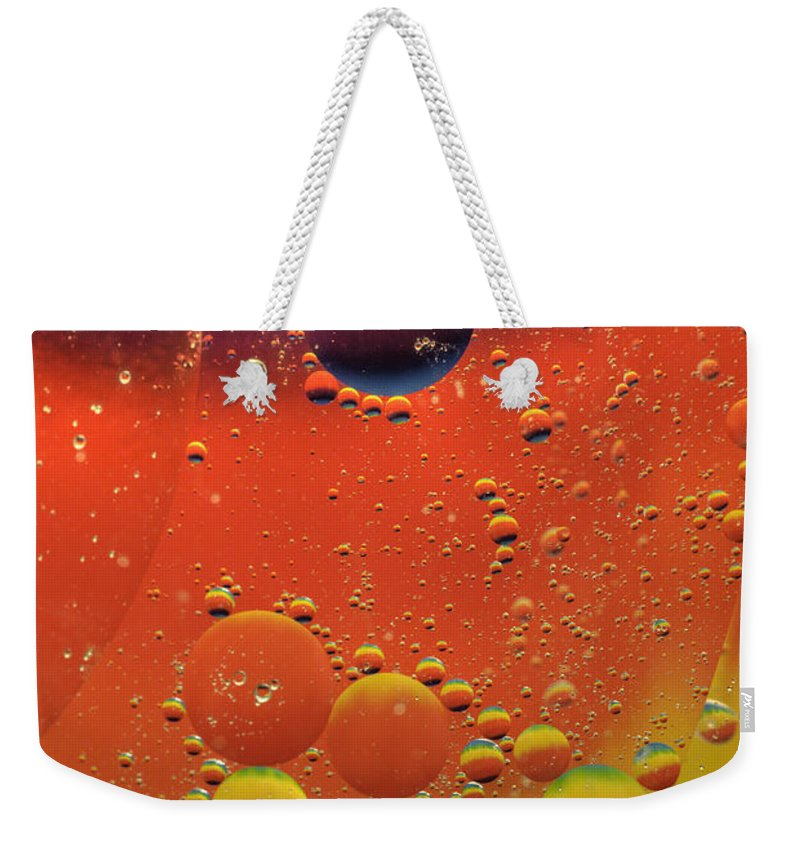 Abstract Weekender Tote Bag featuring the photograph Oil And Water by Anthony Sacco