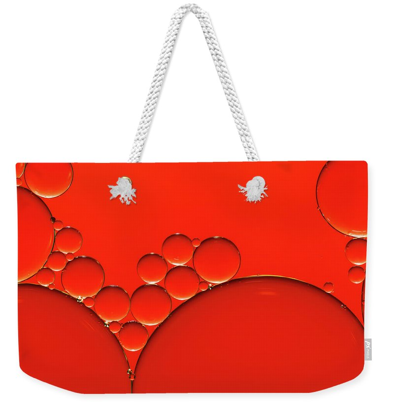 Research Weekender Tote Bag featuring the photograph Oil And Water Drops Background by Assalve