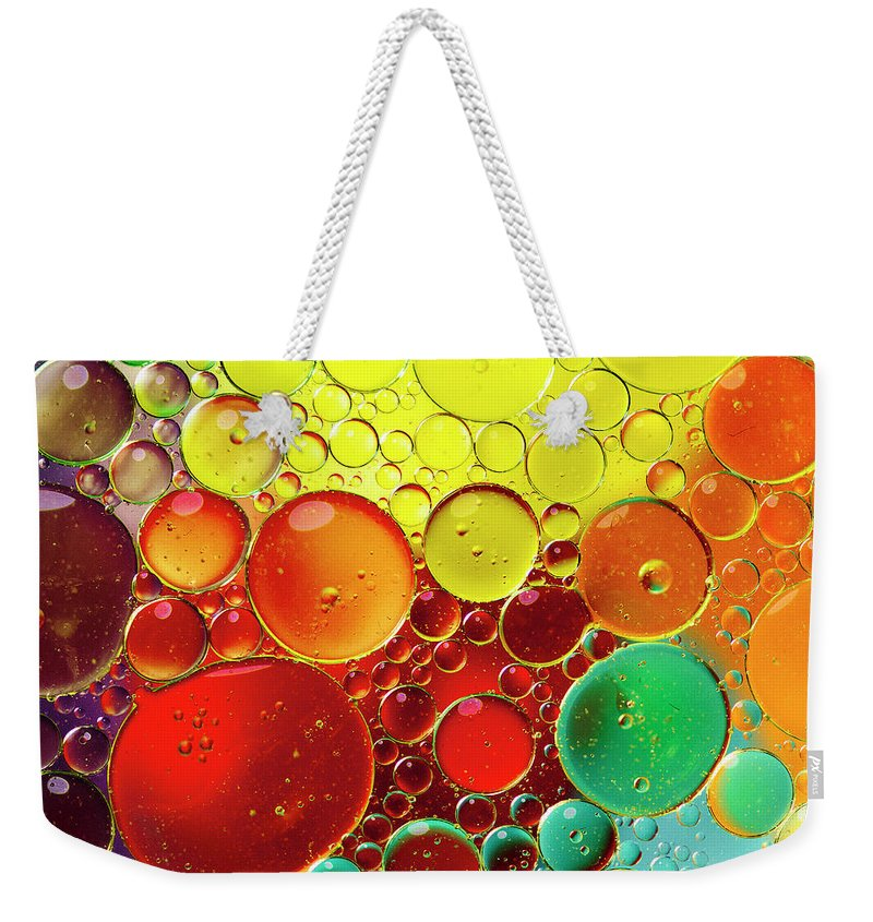 Full Frame Weekender Tote Bag featuring the photograph Oil Bubbles In Water by Ramoncovelo