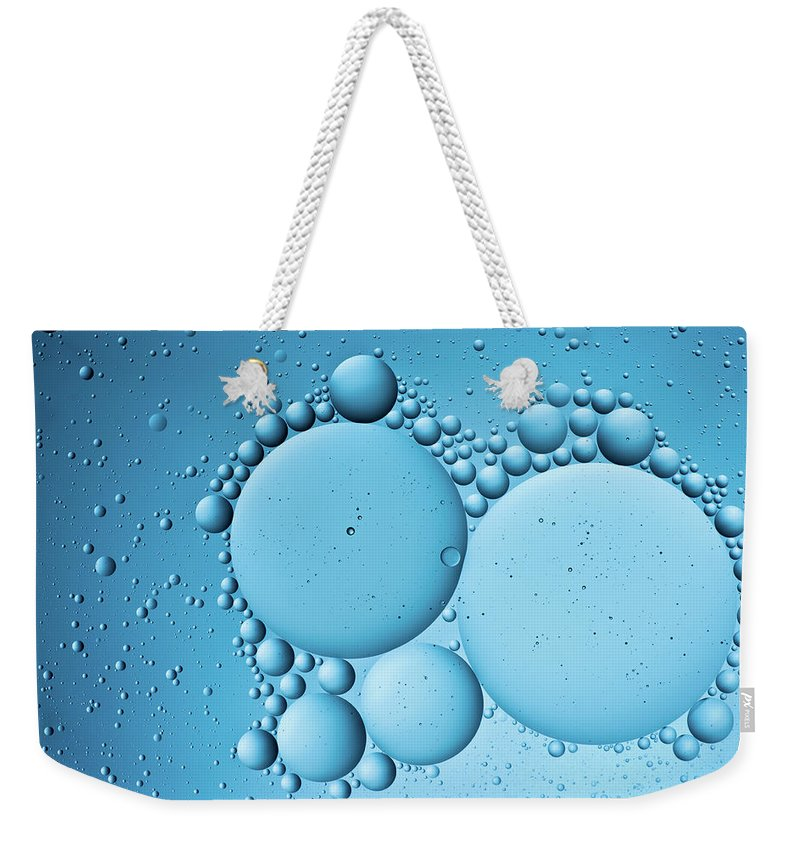 Color Image Weekender Tote Bag featuring the photograph Oil In Water by Daitozen
