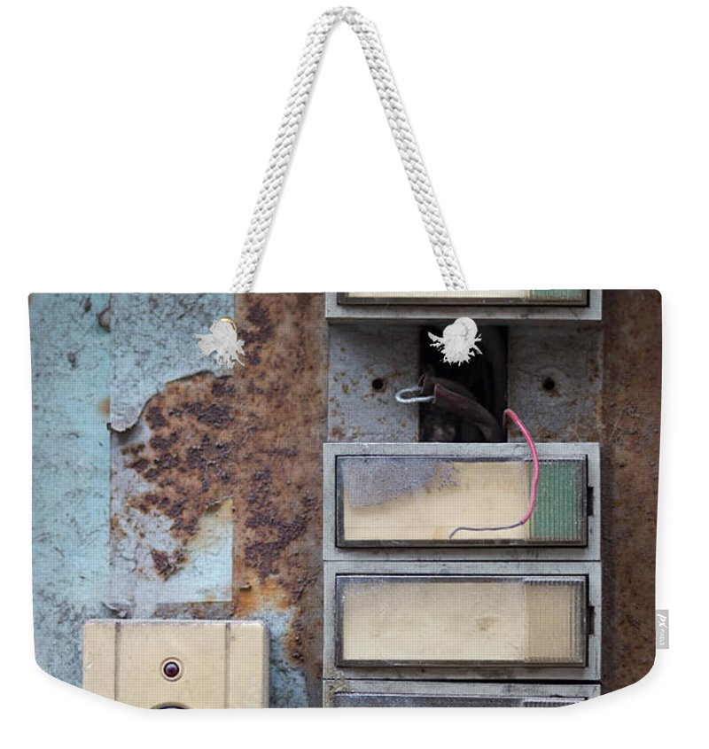 Fresh Weekender Tote Bag featuring the photograph Old And Damaged Doorbells by Michal Boubin