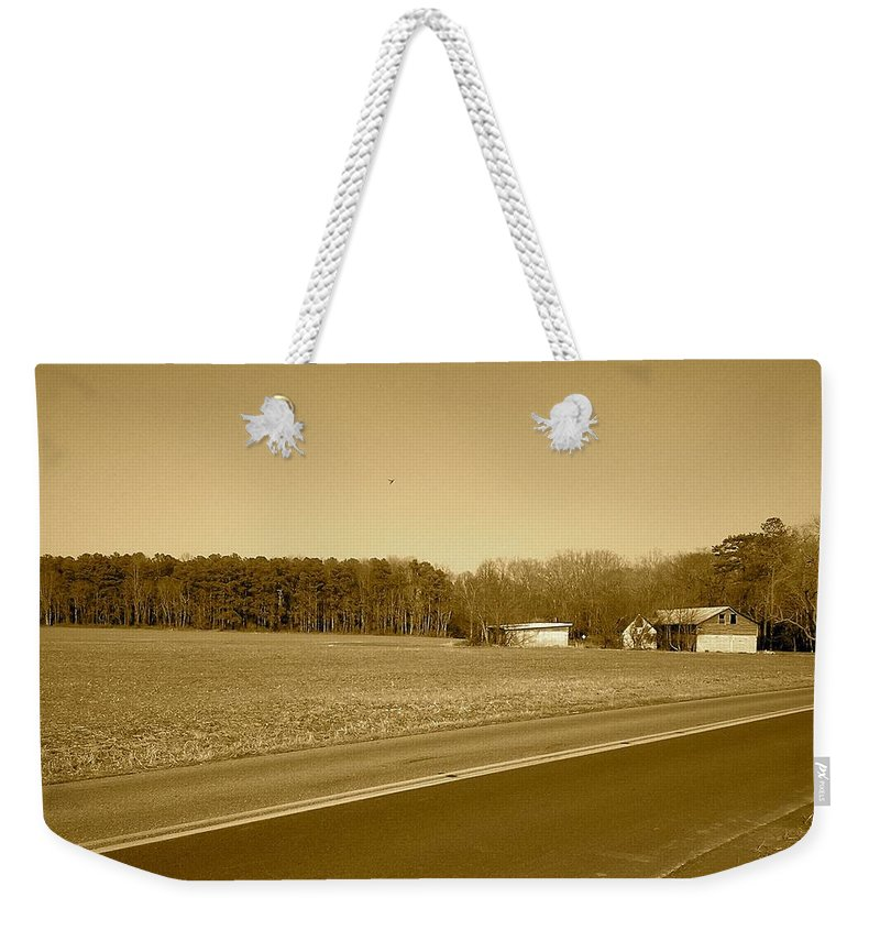 Barn Weekender Tote Bag featuring the photograph Old Barn And Farm Field In Sepia by Chris W Photography AKA Christian Wilson