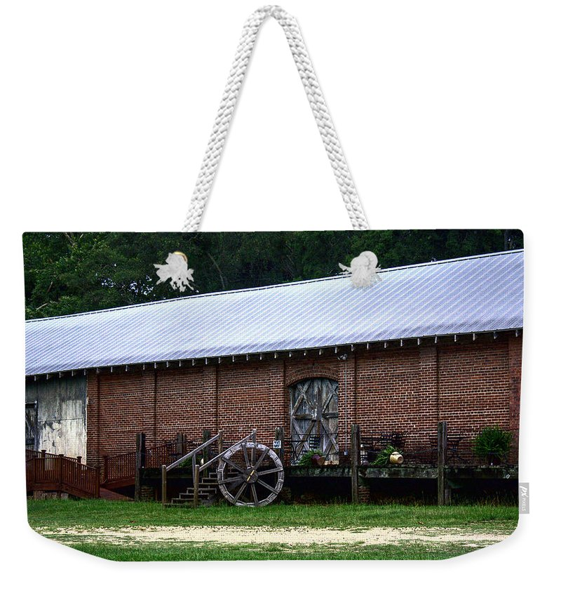 Train Weekender Tote Bag featuring the photograph Old Building by Debra Forand