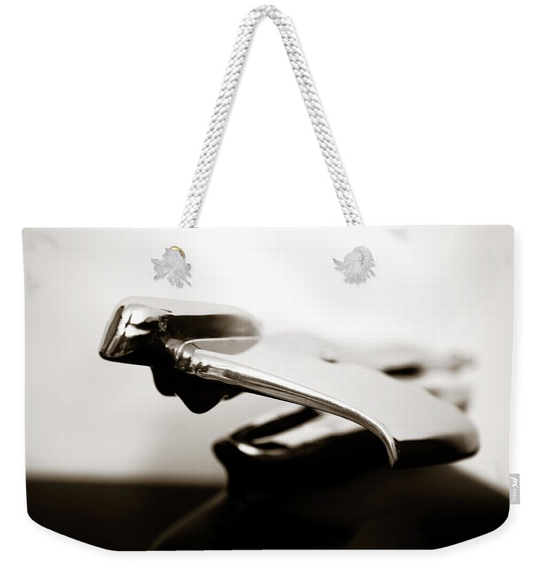 1950s Weekender Tote Bag featuring the photograph Old Car Hood Ornament by Marilyn Hunt