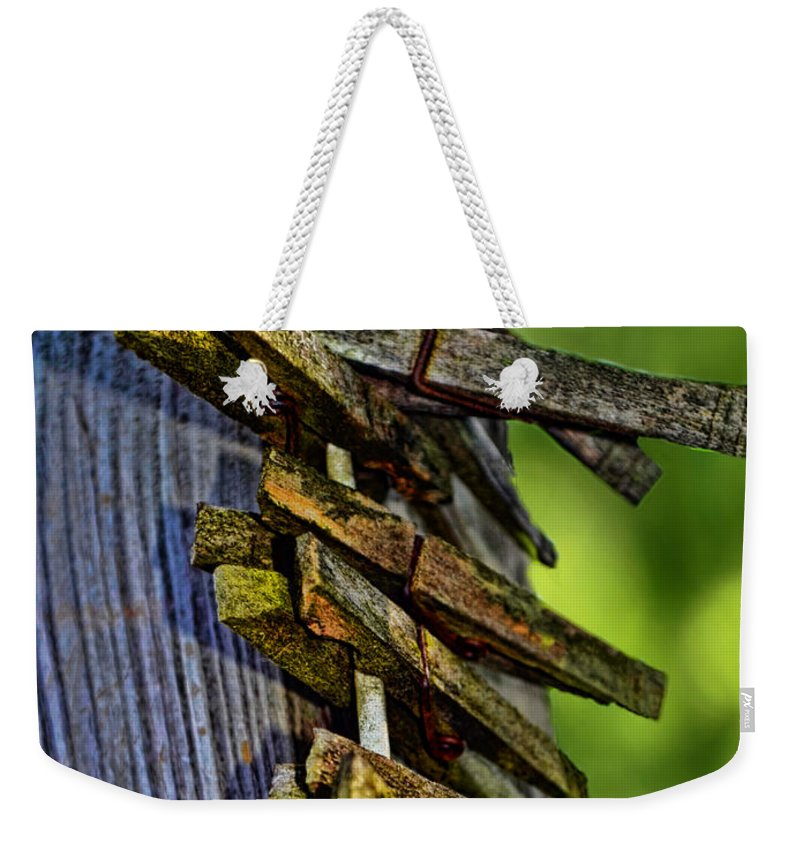 Rustic Weekender Tote Bag featuring the photograph Old Clothes Pins I by Debbie Portwood