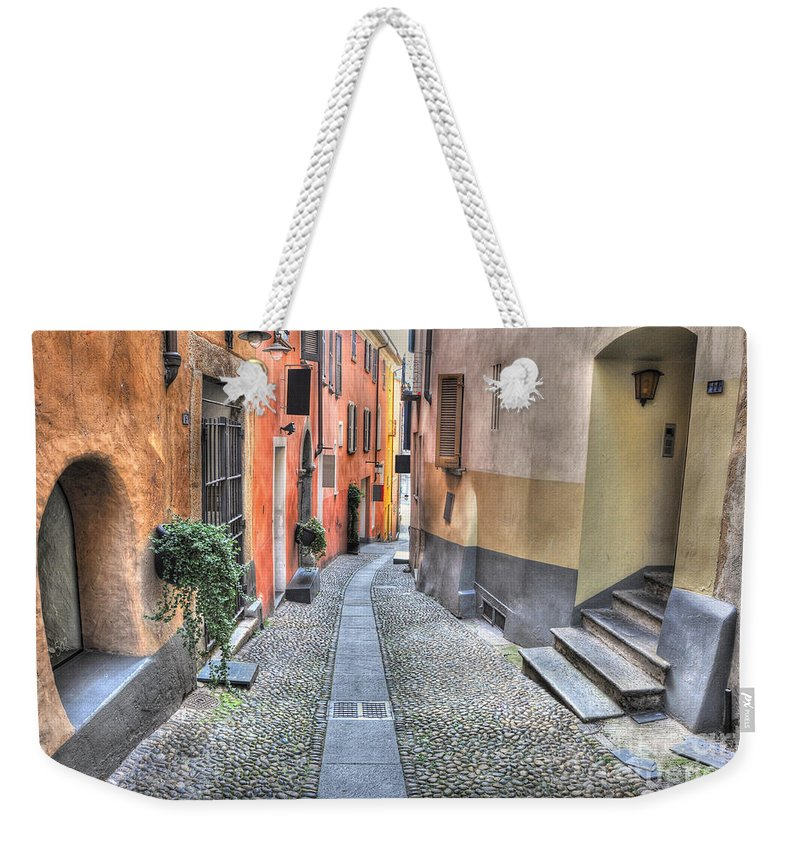 Alley Weekender Tote Bag featuring the photograph Old Colorful Stone Alley by Mats Silvan