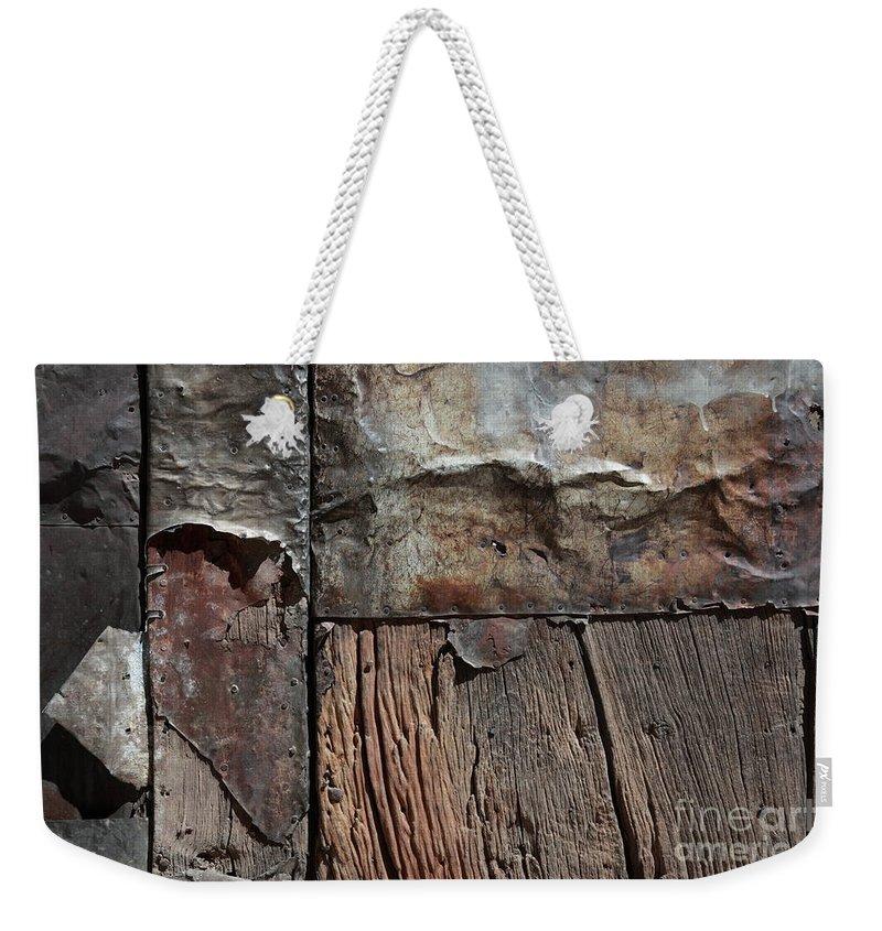 Door Weekender Tote Bag featuring the photograph Old Door Textures by James Brunker