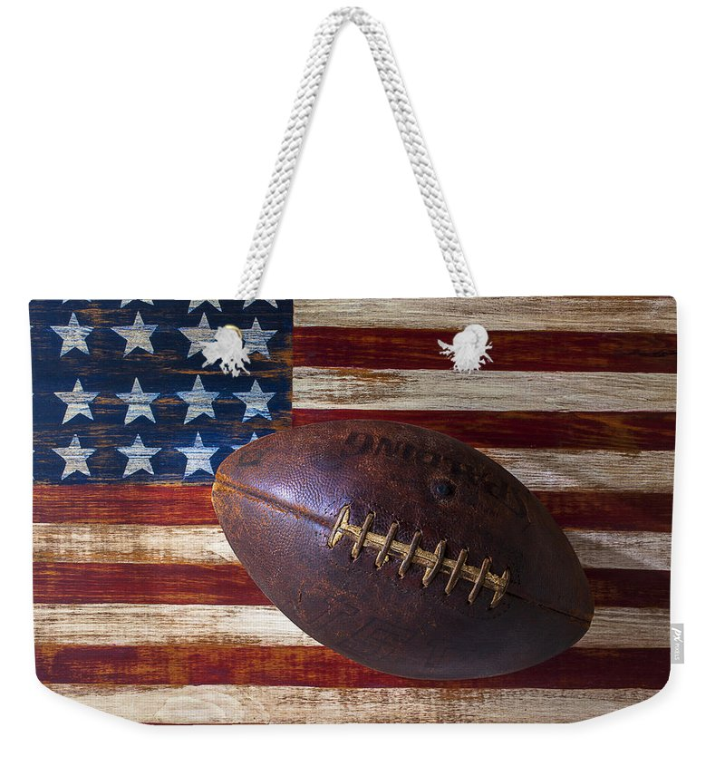 Football Weekender Tote Bag featuring the photograph Old Football On American Flag by Garry Gay