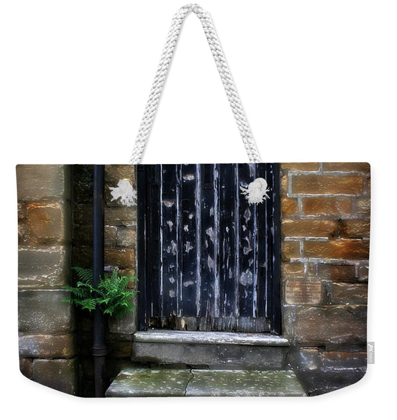 Garden Weekender Tote Bag featuring the photograph Old Forgotten Black Front Door by Doc Braham