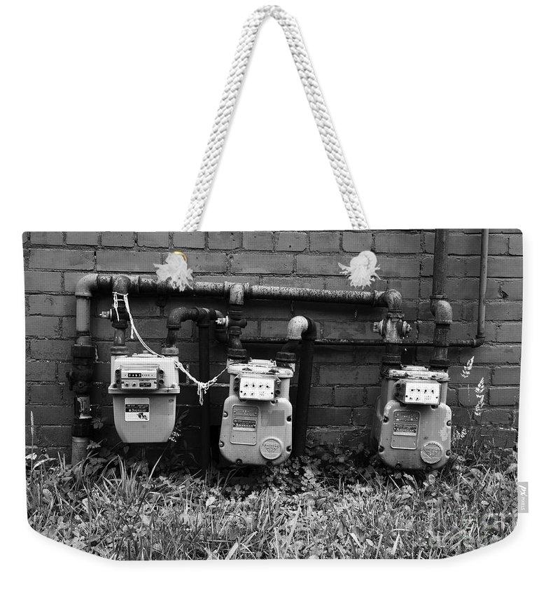 Gas Meter Weekender Tote Bag featuring the photograph Old Gas Meters by James Brunker