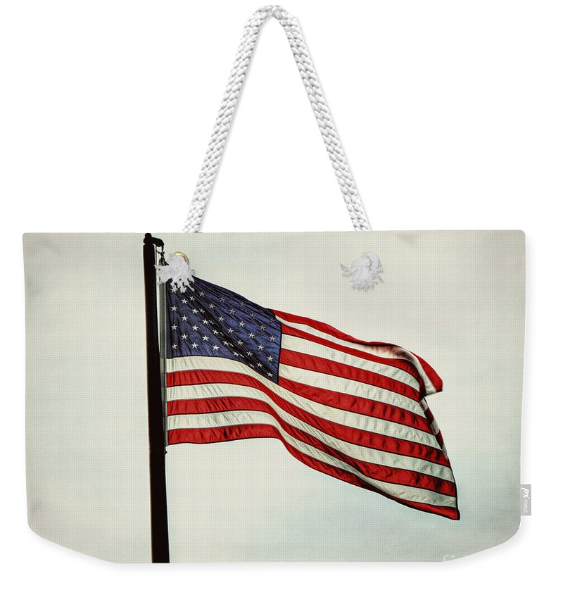 American Flag Weekender Tote Bag featuring the photograph Old Glory In The Wind by Emily Kay