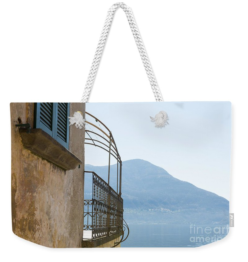 House Weekender Tote Bag featuring the photograph Old House With Lake View by Mats Silvan