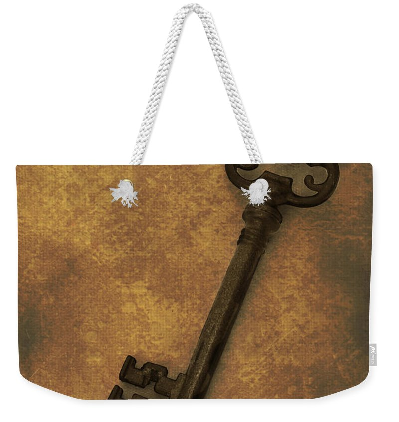 Antique Weekender Tote Bag featuring the photograph Old Key by Amanda Elwell