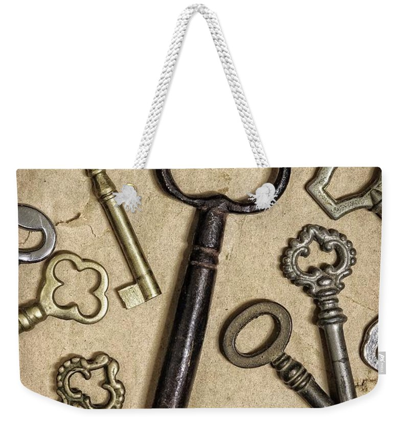 Security Weekender Tote Bag featuring the photograph Old Keys by Carlos Caetano