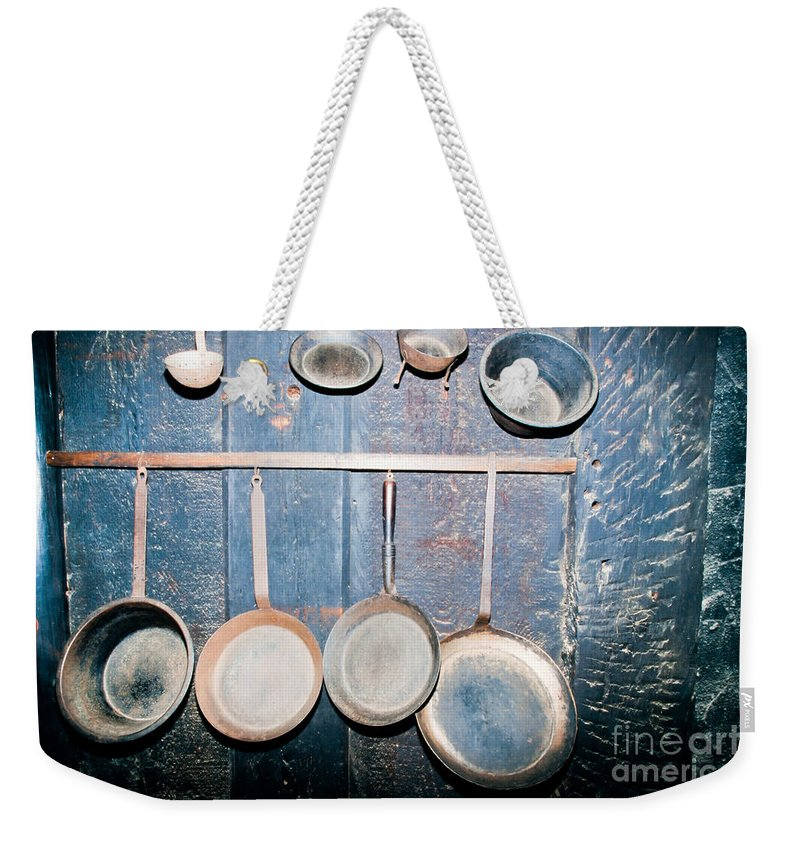 Background Weekender Tote Bag featuring the photograph Old Kitchen Utensils On Soot-black Wall by Stephan Pietzko