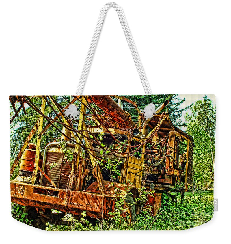 Old Trucks Weekender Tote Bag featuring the photograph Old Logger-hdr by Randy Harris