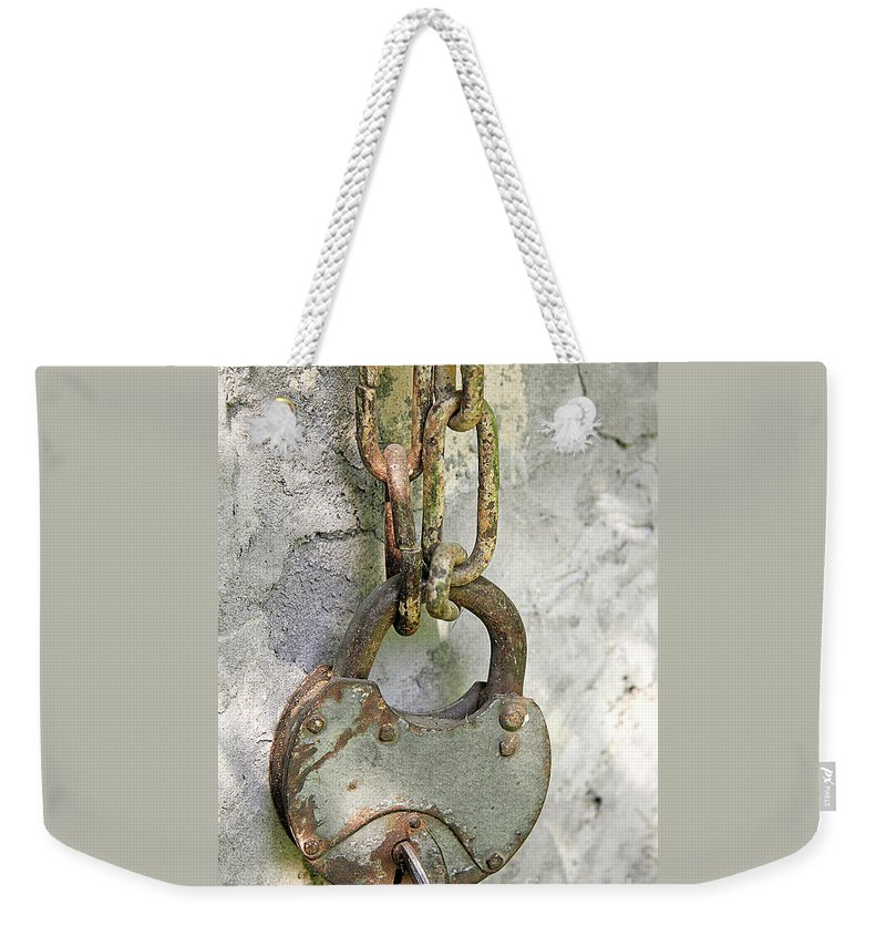 Chain Weekender Tote Bag featuring the photograph Old Padlock by Lali Kacharava